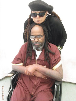 Mumia Abu Jamal had to wheel himself to the visiting room to visit with his wife, Wadiya Jamal, on April 9.