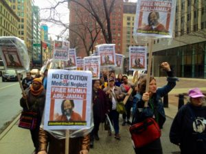 "New Yorkers turned out to march for Mumia, demanding ""No execution by medical neglect! Free Mumia!"" on April 3. – Photo: Ashoka Jegroo, WNV"