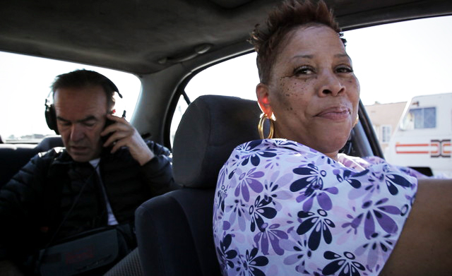 "Pam Brooks guides the ""Tales of the Grim Sleeper"" filmmakers around the neighborhood."