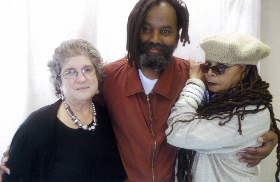On Feb. 6, 2012, a few days after his release from 30 years in solitary confinement on Death Row, Mumia is embraced by attorney RachelWolkenstein and by his wife, Wadiya Jamal.
