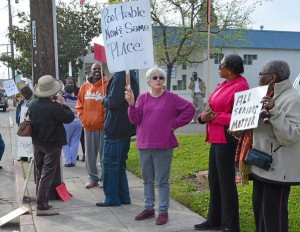 Seniors protest outside the Vallejo Senior Center, calling for the pool table to be returned to its rightful home and to the grandfathers who loved to gather around it. – Photo: Vallejo Times-Herald