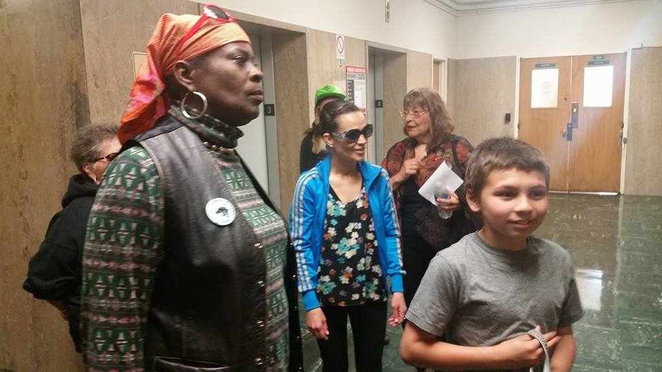 Strong and determined despite the consequences, demonstrators wait for the elevator at 850 Bryant to file elder abuse charges with the District Attorney's Office. – Photo: Poor News Network