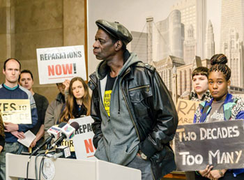 "Darrell Cannon, tortured and framed by Chicago cops in 1983, talks to the press in January. The Chicago City Council voted May 6 to pay reparations to some of the roughly 120 victims of police commander Jon Burge and his ""Midnight Crew"" gang from 1972 to 1991. – Photo: Chicago Torture Justice Memorials"