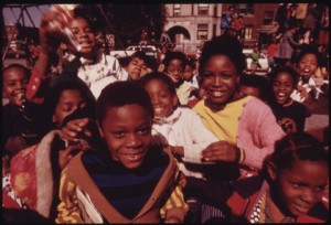 "John White's original caption: ""South Side group of Black children in Chicago at a playground at 40th and Drexel Boulevard, part of nearly 1.2 million people of their race who make up over one third of the city's population. They comprise several of many Black faces in this project that portray pride, love, beauty, hope, struggle, joy, hate, frustration, discontent, worship and faith. In short, portraits of people who feel they are individuals and are proud of their heritage."""