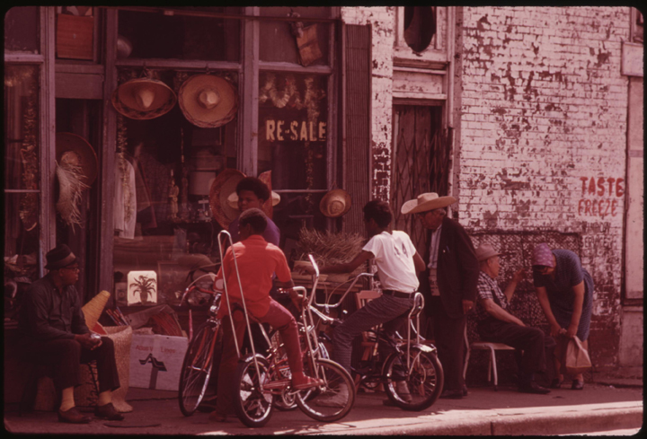 "John White's original caption: ""Sidewalk merchandise on Chicago's South Side. Many of the city's Black businessmen started small and grew by working hard. Today Chicago is believed to be the Black business capital of the United States. Black Enterprise magazine reported in 1973 that the city had 14 of the top 100 Black owned businesses in the country, one more than New York City."""