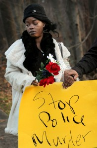 Aretha Russell, first cousin of Malissa Williams, attends a rally Monday, Dec. 3, to protest the police killing of Williams and Timothy Russell in East Cleveland. More than 60 people marched up the hill to Heritage Middle School on Monday evening, where they died in a hail of bullets. With each step, the protesters counted, starting at 1 and ending at the top of the hill with 137, the number of shots fired at the pair. – Photo: Lynn Ischay, Cleveland Plain Dealer