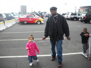 Derrick Jones with his little daughter, Demi. She grew up at Daddy's barber shop, where he cared for her every day while her mother worked.