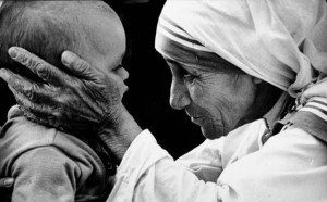 """A Tender Moment with Mother Teresa"" – Photo: John H. White"