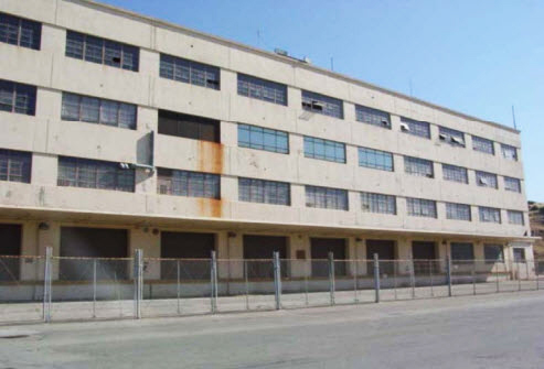 Hunters Point Shipyard Building 813 is a large, 262-by-262-foot, four-story reinforced concrete, flat-roofed building.