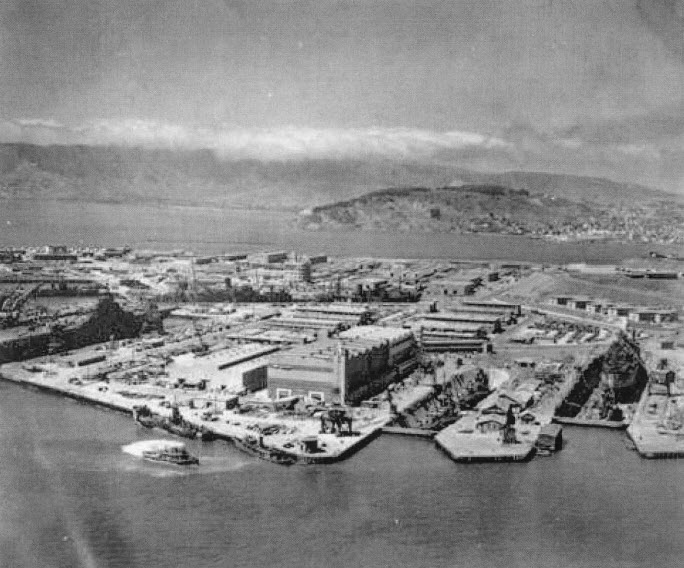 In 1945, when this aerial photo was taken, the Hunters Point Shipyard was the nation's center for radiological research. Some 20,000 people worked there, the majority Black people recruited from Texas and Louisiana and living in barracks on Hunters Point Hill that rises to the right, just out of view in this photo.