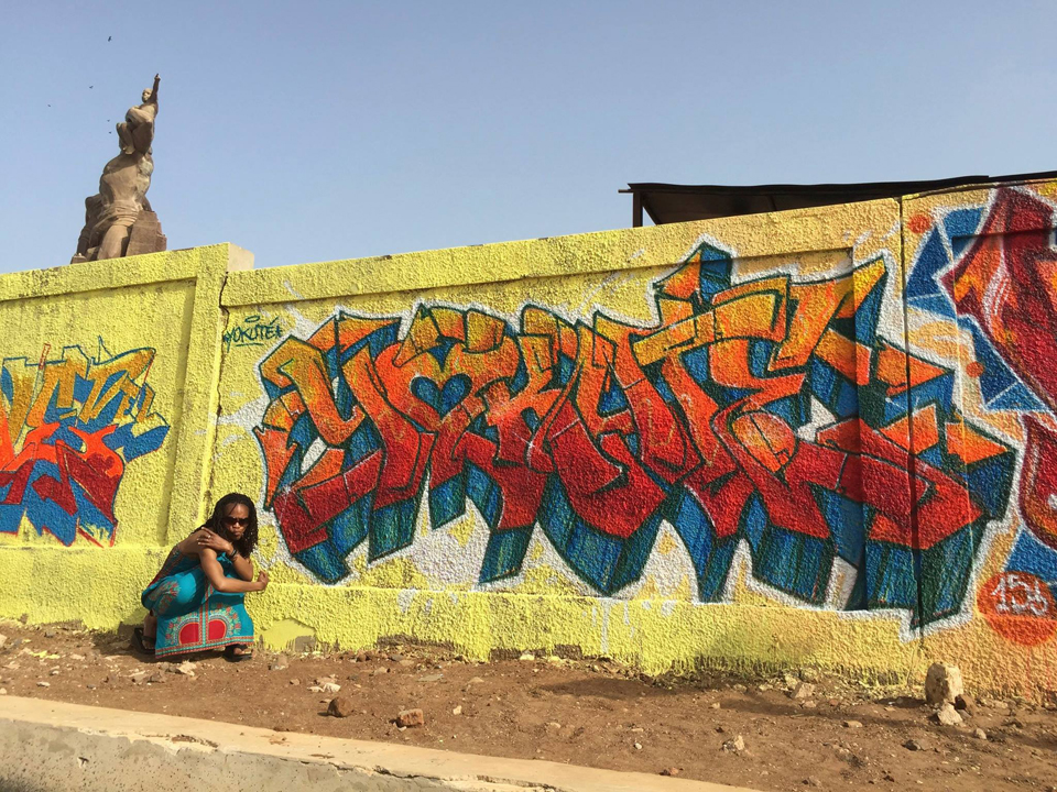 Jonathan Brumfield left this mural behind in Dakar, Senegal, in the shadow of the world-famous African Renaissance Monument. He was there in April teaching art to Senegalese youth.