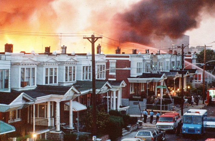To remove the MOVE organization off the face of the earth, Philadelphia bombed from a police helicopter – yes, bombed – the house where the family lived, causing a fire that burned the entire block and consumed 11 people in the MOVE house, six adults and five children. Police shot those who tried to escape the inferno. – Photo: AP