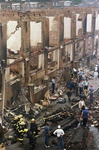 Two days after the bombing, inspectors search the debris, all that was left of the MOVE family's home. – Photo: George Widman, AP