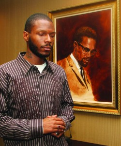 Malcolm-Shabazz-with-Malcolm-X-portrait-at-LA-Sentinel-0710-by-LA-Sentinel-web-250x300, Two years after his murder, his imam recalls the life of Malcolm Latif Shabazz, Local News & Views