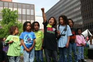 MOVE children cry out passionately to free Mumia Abu-Jamal at a rally on May 17, 2007, in Philadelphia. Succeeding generations of MOVE children learn about the 1978 attack and the 1985 bombing – and about Mumia Abu-Jamal, who as a journalist has always strongly supported the organization, both before and since his imprisonment in 1981. – Photo: JR Valrey, Block Report