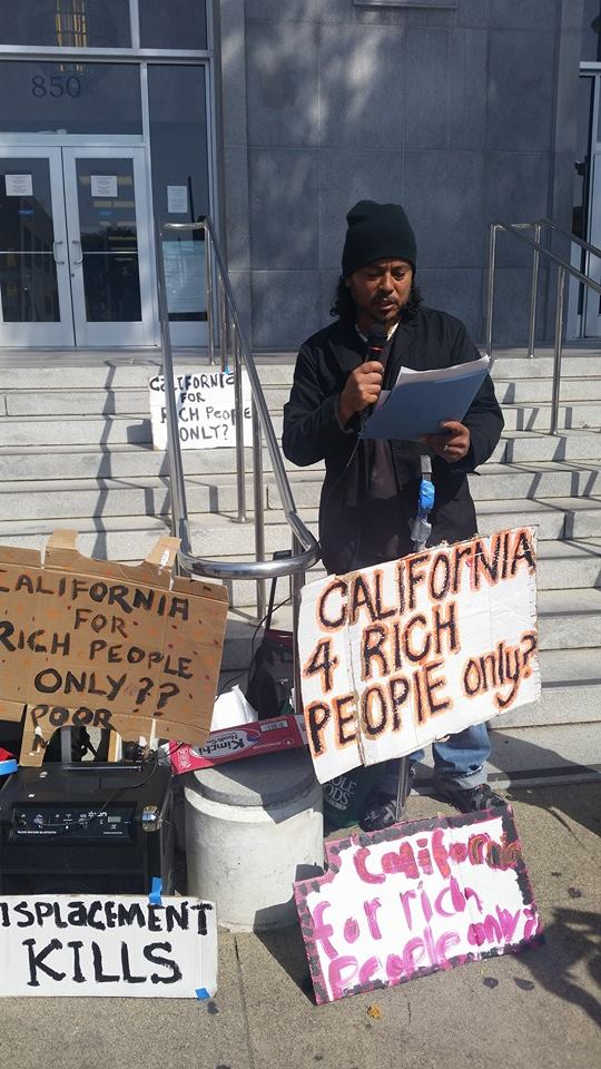 Tony Robles speaks at an anti-eviction rally outside 850 Bryant, San Francisco's Hall of Injustice. – Photo: Poor News Network