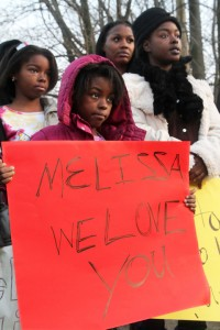 Aretha Russell, right, first cousin of Malissa Williams, her children, LeVatruis Bridges, 10, Dalyla Bridges, 8, holding the sign, and cousin Gabrylle Jeffries protest at the Dec. 3 rally. – Photo: Lynn Ischay, Cleveland Plain Dealer