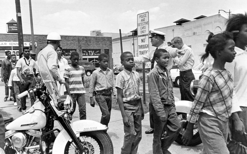 """During the Birmingham Children's Crusade May 2-5, 1963, 3,000 school children from about 8 to 18 marched daily and were arrested and re-arrested daily. Every day they walked out of their classrooms to the 16th Street Baptist Church to be dispatched. """"(T)here were not enough adults prepared to be arrested. So the Children's Crusade turned the tide of the movement,"""" says historian Clayborne Carson. On May 11, 1963, Bull Connor was fired after 22 years as police chief."""
