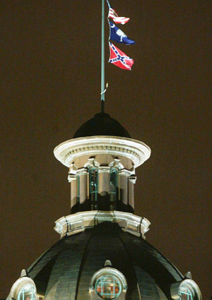 The Confederate flag that flies over the South Carolina Capitol has been contested for decades by Black state legislators and the public. No longer atop the Capitol building, it remains a stone's throw away on the Capitol grounds. – Photo: Mark Wilson