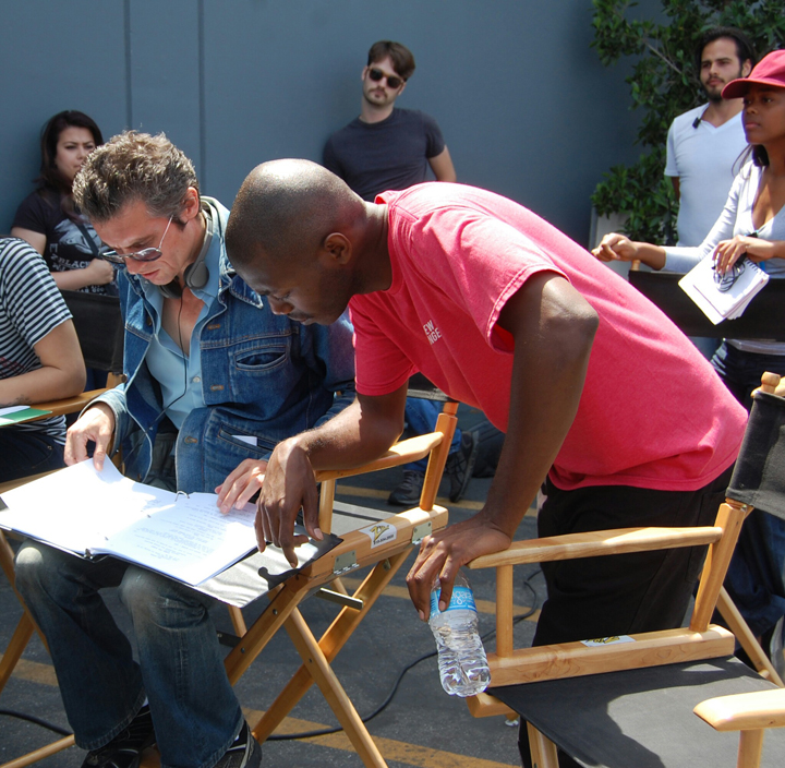 Paul and Dominique check the script.