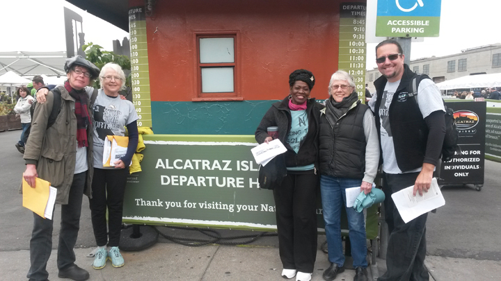 In San Francisco at Pier 33, where tourists catch the ferry to Alcatraz, activists distributed fliers telling the history of solitary confinement in California, beginning with Alcatraz. Marie Levin (center), the exemplary activist sister of Sitawa Nantambu Jamaa, an exemplary prisoner activist, was there with other dedicated advocates. – Photo: Mike Bishop