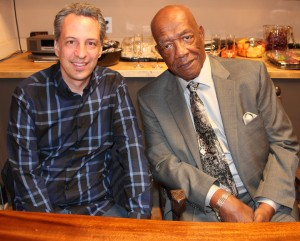"""Patrick Gilles, director of """"America Is Still the Place,"""" and Charlie Walker, author of the autobiography the film is based on, are interviewed at African Plural Art during a press conference. – Photo: Johnnie Burrell"""