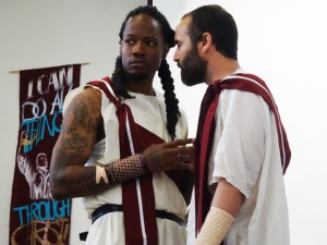 "Maurice 'Reese' Reed as Cassius and Carlos Flores as Brutus confer in this scene from San Quentin's ""Julius Caesar."" – Photo: Wanda Sabir"