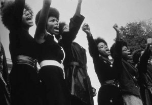 Women of the Black Panther Party in Sacramento sing at a Free Huey rally. – Photo: Pirkle Jones