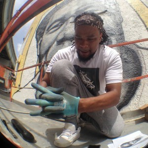 "Brandan ""Bmike"" Odums is the artist-activist who created the mural. Visit his website at BrandanOdums.com. – Photo: Doug MacCash, Times-Picayune"