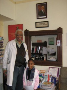Dr. Small and a young patient smile on the day Barack Obama was elected president, Nov. 6, 2007. They're in his Harriet Tubman Medical Office, a restored Victorian built in the late 1800s.