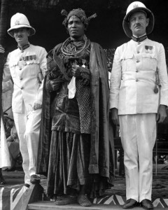 The Earl of Plymouth (right) and Sir John Macpherson, governor-general of Nigeria, visit the oba of Benin, Oba Akenzua II, in Benin City, Nigeria, in about 1938. Oba Akenzua II holds the coral regalia of Oba Ovonramwen, which the British took in 1897 and returned in the mid- to late 1930s. This photo is in the Smithsonian's Chief S.O. Alonge Collection. Chief Alonge was the official photographer to the Royal Court of Benin. – Photo: Chief S.O. Alonge