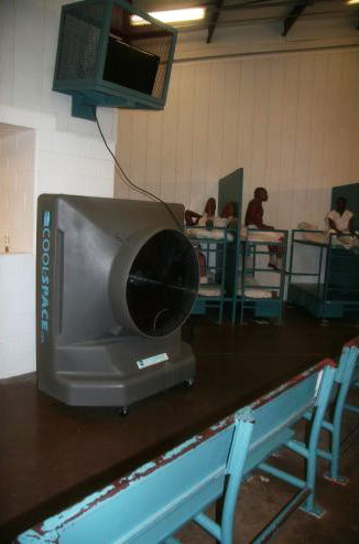 "This is a cooling fan installed in early summer 2014 at the TDCJ Holliday Unit near Huntsville, Texas. ""The nation's most populous prison system, facing legal actions and criticism about inmates having to endure oppressive Texas summer heat, is looking to make conditions a bit more bearable at seven state prisons,"" reports AP. – Photo: Michael Graczyk, AP"