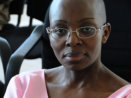 Rwandan opposition leader, Victoire Ingabire, poses at the Rwandan High Court as her trial enters its 9th week in Kigali, Rwanda on November 10, 2011. Charges against Ingabire, which critics say are politically motivated,  include giving financial support to a terrorist group, planning to cause state insecurity, divisionism and the controversial charge of ?genocide ideology?. AFP PHOTO/STEVE TERRILL (Photo credit should read STEVE TERRILL/AFP/Getty Images)