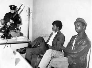 "The photographer's caption reads ""Black Panthers Bobby Seale and Bobby Hutton detained at the Oakland Police Dept. while officers check guns. Hutton was shot and killed by police shortly after this photo when he and Eldridge Cleaver were involved in a shoot-out with Oakland Police. (1967 photo by Ron Riesterer)"" Actually, Lil Bobby Hutton, the first person to join the Black Panther Party shortly after its founding in October 1966, when he was only 15, was killed on April 6, 1968, two days after Martin Luther King was assassinated."