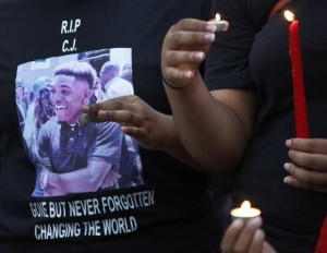 Outside a church in Arlington, Texas, a suburb of Dallas, Christian Taylor's friends and family held a vigil the day after his murder. – Photo: Louis DeLuca, AP