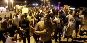 Ferguson takes to the streets again Tuesday, Aug. 11, during more than a week of protests around the first anniversary of the Aug. 9, 2014, murder of Michael Brown by Officer Darren Wilson. – Photo: Charlie Riedel, AP