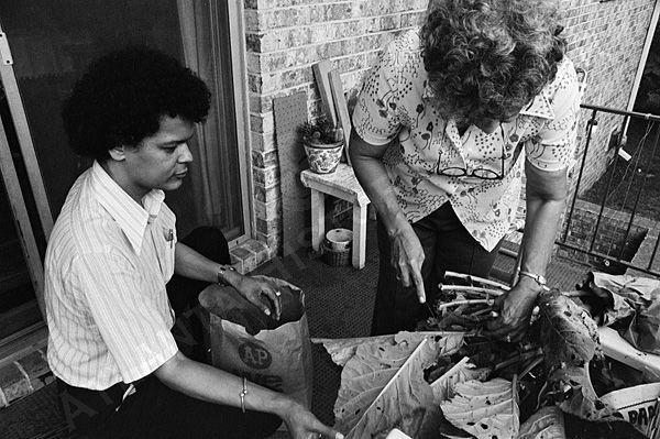 Georgia state Sen. Julian Bond prepares collard greens with his mother at home in Atlanta in 1975. – Photo: Boyd Lewis