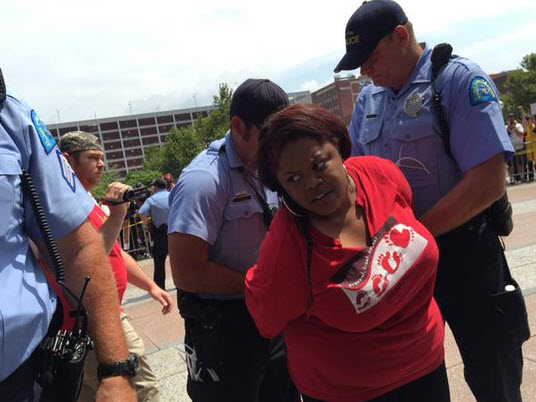 Johnetta Elzie, a prominent member of the Black Lives Matter movement, is arrested outside the U.S. Attorney's Office in St. Louis on Monday. – Photo: Ryan J. Reilly, HuffPost