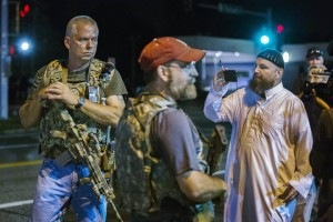"""Oath Keepers, former police, military and """"first responders,"""" invade Ferguson on Aug. 11, two days after the first anniversary of Mike Brown's police lynching, showing off their """"open carry"""" permitted weapons. – Photo: Lucas Jackson, Reuters"""
