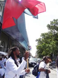 Pan African flag bearer in the 15th Annual New Orleans Maafa Commemoration – Photo: Wanda Sabir