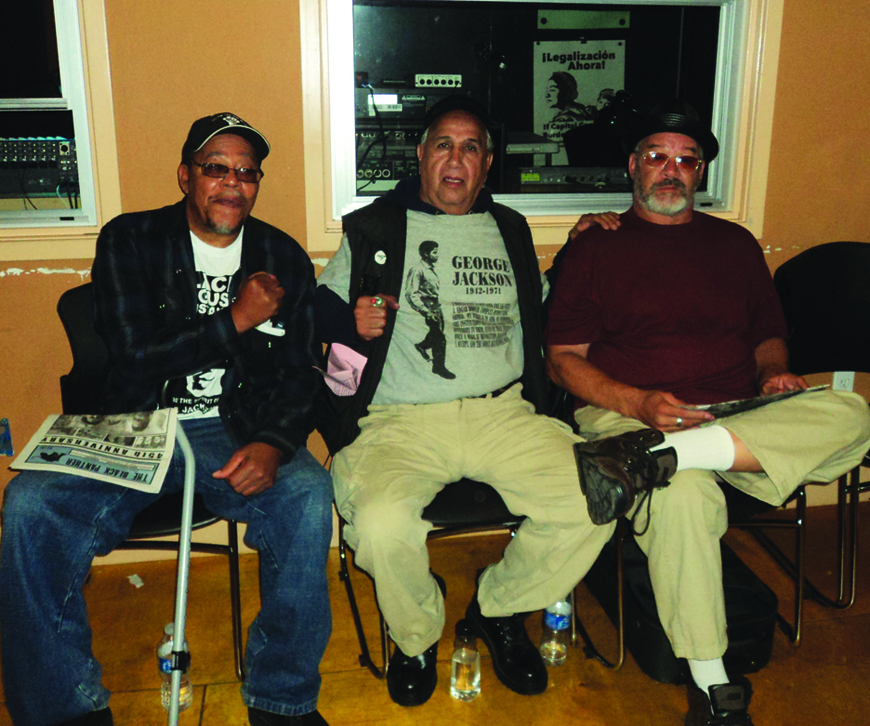 At Geronimo Day in Oakland on Aug. 21, 2011, are three of the then four surviving members of the San Quentin 6: Willie Sundiata Tate, Luis Bato Talamantez and David General Giap Johnson. The fourth was Hugo Pinell, still in prison, locked in solitary confinement for over four decades. – Photo: Sue Acevedo