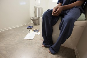 A youngster endures the torture of solitary confinement. – Photo: Richard Ross, Juvenile Justice Information Exchange