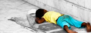 homeless-child-roadside-sleeping