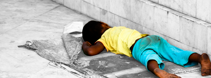 homeless-child-roadside-sleeping