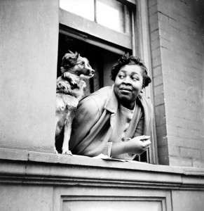 """Woman and Dog in Window,"" Harlem 1943 – Photo: Gordon Parks"