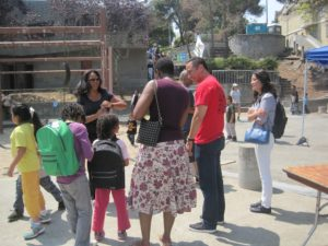 Public Defender Jeff Adachi, founder of BMAGIC and a much loved figure in Bayview Hunters Point, talks with a family – the children sporting their brand new backpacks – in beautiful Youngblood Coleman Park, located on a steep, wooded hillside in Hunters Point.