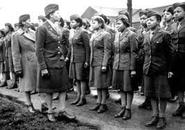 A Black unit of the World War II era Women's Army Corps (WACs) stand for inspection.