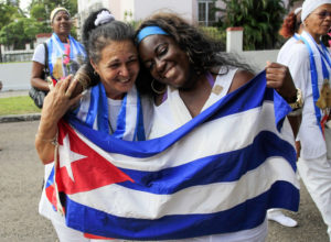 Recently released dissidents Aide Gallardo and Sonia Garro hold the Cuban flag during a march in Havana Jan. 11, 2015, when Cuba freed 53 prisoners. – Photo: Reuters