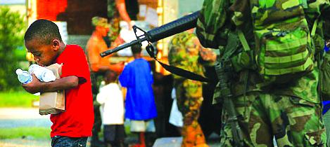 Katrina-soldier-child, From Katrina to Ferguson, National News & Views