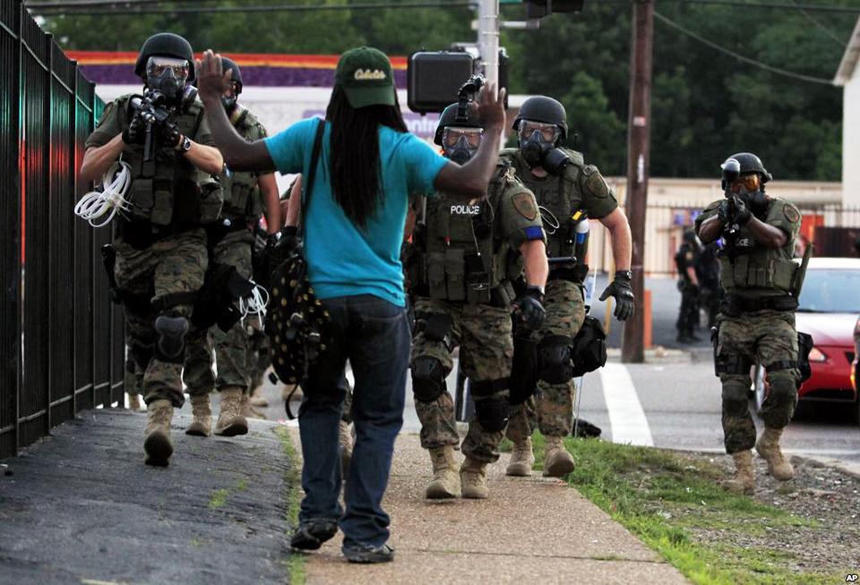 Michael-Brown-murder-aftermath-white-cops-in-riot-gear-aim-gun-at-Black-man-hands-raised-Ferguson-Mo-081114-by-AP-VOA, From Katrina to Ferguson, National News & Views